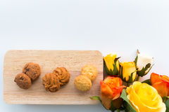 Assorted cookies on wooden boards White background and rose. Top view assorted cookies on wooden boards White background and rose. Chocolate chip cookies royalty free stock photo