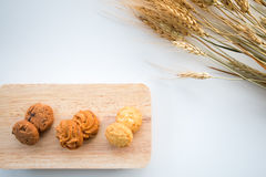 Assorted cookies on wooden boards White background and wheat. Top view assorted cookies on wooden boards White background and wheat. Chocolate chip cookies royalty free stock photography