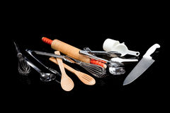 Assorted cooking utensils on black Royalty Free Stock Photography