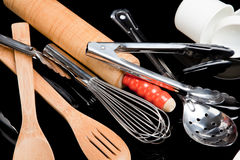 Assorted cooking utensils on black Royalty Free Stock Image