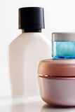 Assorted cosmetics bottles. Closeup background royalty free stock photography