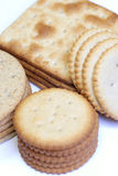 Assorted crackers. Stacks of assorted crackers on white background Royalty Free Stock Image