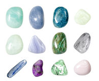 Assorted Crystal Gemstones 3. Assorted collection of 12 semi precious gemstones and crystals isolated on white. Blue lace agate, aquamarine, apatite, fushite Stock Images