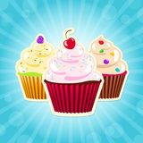 Assorted cupcakes on blue background illustration Royalty Free Stock Images