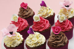 Assorted cupcakes. Assorted bright coloured decorative cupcakes stock images