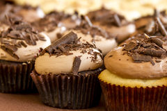 Assorted Cupcakes on Display. Chocolate and vanilla cupcakes with chocolate shavings sitting on display table Stock Photo