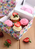 Assorted cupcakes in the paper box. Assorted cupcakes in the colorful paper box Royalty Free Stock Photo