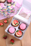 Assorted cupcakes in the paper box. Assorted cupcakes in the colorful paper box Royalty Free Stock Photos