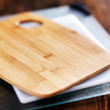Assorted cutting boards in a pile Stock Photos