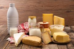 Assorted dairy product. On wood background royalty free stock photography