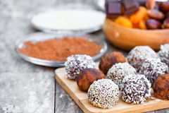 Assorted dark chocolate truffles with  cocoa powder sesame seeds Royalty Free Stock Images