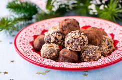 Assorted dark chocolate truffles on red plate Royalty Free Stock Images