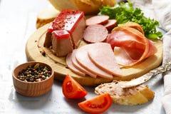 Assorted deli meats - ham, salami, parma, prosciutto Royalty Free Stock Photos