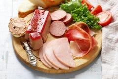 Assorted deli meats - ham, salami, parma, prosciutto Stock Image