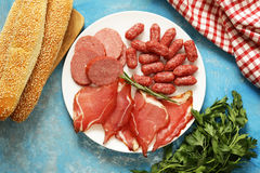 Assorted deli meats - ham, sausage, salami, prosciutto Stock Images