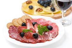 Assorted deli meats, plate of cheese and glass of wine closeup Stock Photography