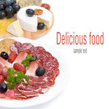 Assorted deli meats and a plate of cheese and grapes, isolated Stock Image