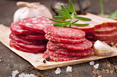 Assorted deli meats and rosemary Stock Images