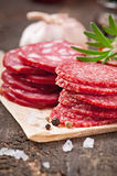 Assorted deli meats and rosemary Stock Photography