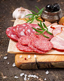 Assorted deli meats and rosemary Stock Photos