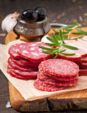Assorted deli meats and rosemary Royalty Free Stock Image