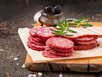 Assorted deli meats and rosemary Royalty Free Stock Photography
