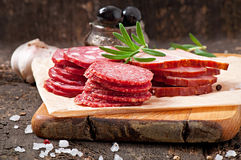 Assorted deli meats and rosemary Royalty Free Stock Photos