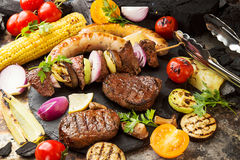 Assorted delicious grilled barbecue meat with vegetable. Beef gr royalty free stock image