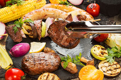 Assorted delicious grilled barbecue meat with vegetable. Beef gr Royalty Free Stock Photo