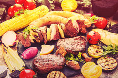 Assorted delicious grilled barbecue meat with vegetable. Beef gr Stock Photos