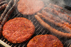 Assorted delicious grilled meat over the coals on a barbecue Royalty Free Stock Image