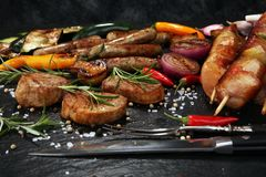 Assorted delicious grilled meat with vegetable on a barbecue Royalty Free Stock Photos