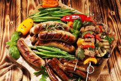 Assorted delicious grilled meat with vegetable on a barbecue. Grilled pork shish or kebab on skewers with vegetables . Food royalty free stock photos