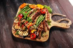 Assorted delicious grilled meat with vegetable on a barbecue. Grilled pork shish or kebab on skewers with vegetables . Food royalty free stock images