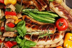 Assorted delicious grilled meat with vegetable on a barbecue. Grilled pork shish or kebab on skewers with vegetables . Food stock photo