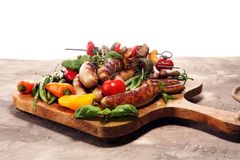 Assorted delicious grilled meat with vegetable on a barbecue. Grilled pork shish or kebab on skewers with vegetables . Food royalty free stock photography