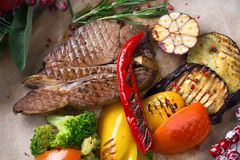 Christmas layout of meat steak with vegetables royalty free stock photo