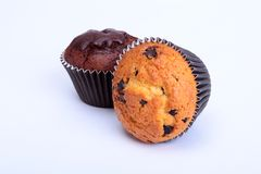 Assorted with Delicious homemade muffin, cupcake with raisins, nuts and chocolate isolated on white background. royalty free stock images