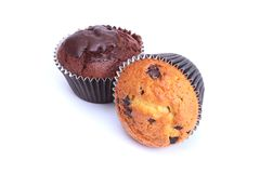 Assorted with Delicious homemade muffin, cupcake with raisins, nuts and chocolate isolated on white background. royalty free stock photo