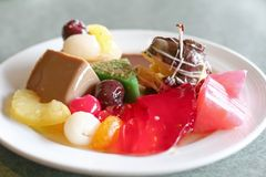 Assorted deserts. Assorted desserts pastries and jellies in a plate stock images