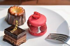 Assorted dessert in afternoon tea set. Assorted desserts with fork in afternoon tea set stock photography