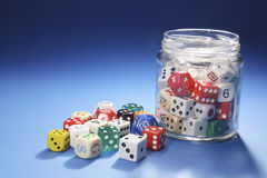 Assorted Dice in Glass Jar Royalty Free Stock Photography