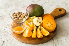 Assorted different fruits. Persimmon, apple, oranges stock image
