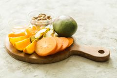 Assorted different fruits. Persimmon, apple, oranges stock photography