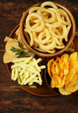 Assorted different kinds of chips - onion rings, sticks Royalty Free Stock Images