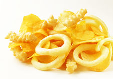 Assorted different kinds of chips - onion rings, sticks Stock Photo