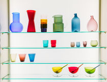 Assorted Different Sizes And Shapes Of Colorful Glassware On She Stock Photography