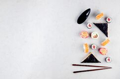 Assorted different sushi and rolls with soy sauce, ginger, wasabi