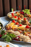Assorted dinner party plateaus. stock photos