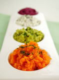 Assorted Dips. Of beetroot, carrot, cottage cheese and herbs and pea and basil royalty free stock image